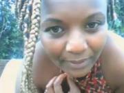 African girl flashing outdoors