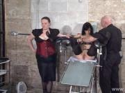 Feet tortures of slave Elise Graves in dungeon bondage