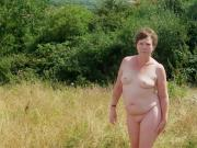 Small titted milf suzy, naked walk across the field