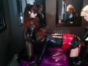 Tranny Latex Slut spitroasted by two beautiful dommes!