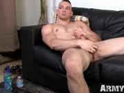 Handsome trooper grabs his hard cock and masturbates solo