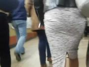 MILF's ass in grey skirt