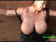 Granny Kim sucks cock outdoors
