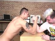 Fat wink and a muscular hunk have an arm wrestling contest