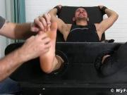 Bound jock giggles while being tickled by two horny gay men