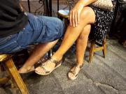 Teen crossed sexy legs feets toes hands at cafe