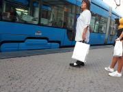 Girl wait for tram 6