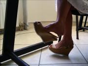 candid feet dangling of laure under the table