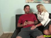 Lingerie milf jerking hard cock in stockings