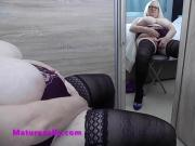 Sally admires her curves in the mirror