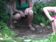 Young girls pissing in the forest