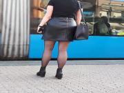 Girl wait for tram black stockings