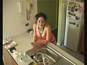 Punk girl using a waterhose to get off
