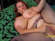 Huge busty babe with a diamond ass plug