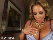 Hot MILF in lingerie fucks her pussy
