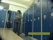 Middle-aged mother undresses in locker room
