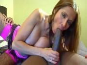 Big tits Milf enjoys sucking black guys big cock