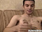 Hairy young guy tugs raging dick and cums all over the place