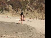 asian nude playing at baker beach 1