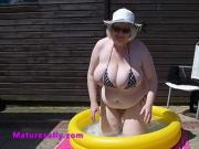 Sally outdoors trying to cool her big tits