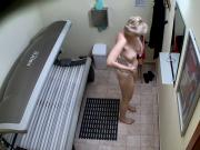 Older MILF Tanning her Shaved Tight Pussy