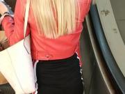 Pantyhose and short skirt on escalator