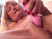 Skinny granny Nancy masturbated with dildo