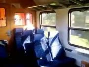 Wife with glass suck on train
