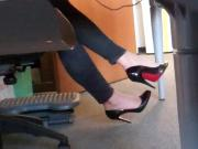 dangling louboutin under desk 4