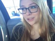 Pretty blonde talking sexy in the car