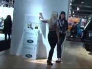 Two girls bare feet to the motor show