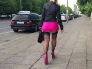 Sexy Lady walking public in stockings and a short skirt.