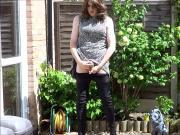 Sexy masturbating crossdresser in thigh boots outdoors