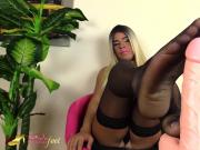 Blonde shemale does a footjob with her feet in black nylons