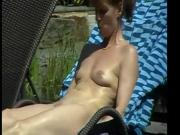 Naked girl in a german sauna garden 4