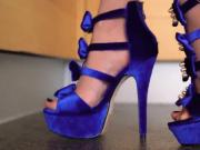 Zoom on new blue high heel sandals in the kitchen.