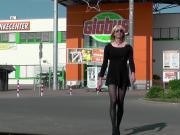 Crossdresser Tranny goes outside in minidress
