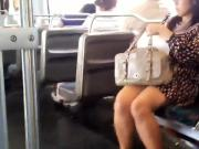 Sexy nervous asian lady in short dress on the train