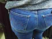 Bubble butts saleswoman in tight jeans