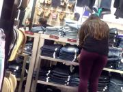Sexy store attendant in purple leggings