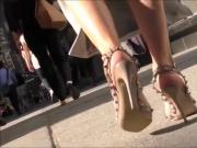 Candid Woman Walking In High Beige Studded Sandals
