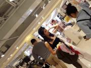 Candid voyeur Asian girl showing ass while shopping