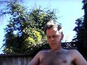 Backyard stroking my dick