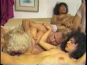 Curly hair brunette Kim Carson gets her cunt licked in 80s orgy