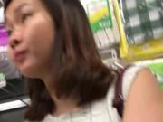 OL in white dress supermarket face