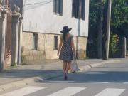pretty legs woking on street in mini dress