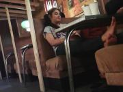 Candid feet of Indian girl in cafe