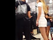 Candid voyeur hot blonde in tight short dress shopping mall