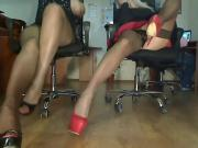 webcam of two long legs in heels