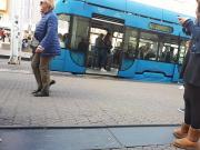 Girl wait for tram 5